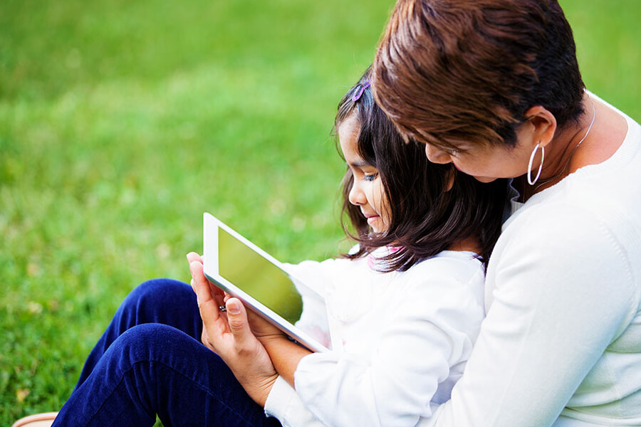 Mother and daughter looking at a tablet together